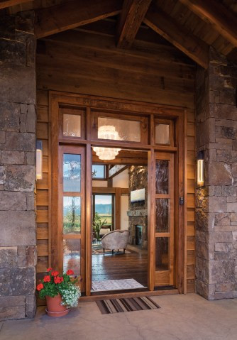 The front door is made of custom walnut and fitted with custom glass work.