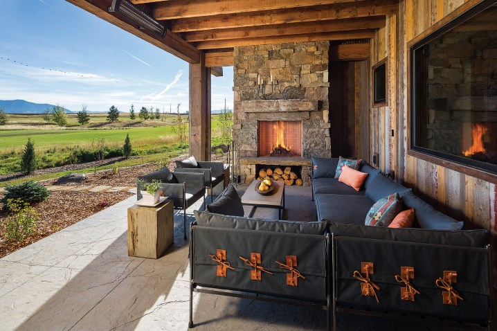 The covered porch boasts its own stone fireplace and outdoor heaters, making it comfortable even on chilly evenings.
