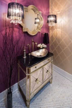 The powder room is a clear departure from the rustic aesthetic..