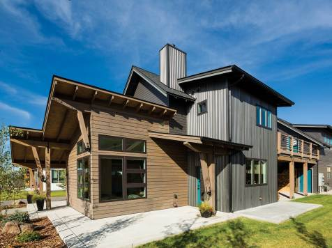 Steel siding blends naturally with wood and concrete for a simple, modern design style. Photo by Karl Neumann