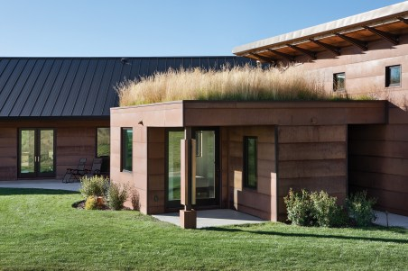 A sod roof links the guest room and main house, tying the home back into the natural setting and softening its impact on the environment.