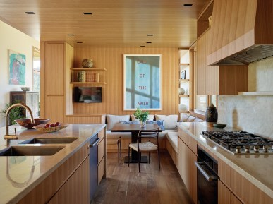 Quarter-sawn cherry cabinets add clean, modern lines in the kitchen and throughout the house.