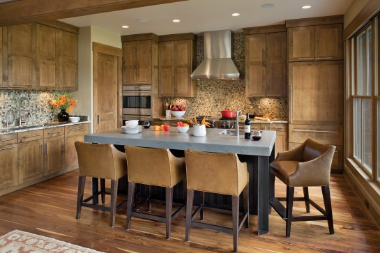 With its floor-to-ceiling double-hung windows, the spacious kitchen offers generous views to the south and west and a place to both cook and gather.