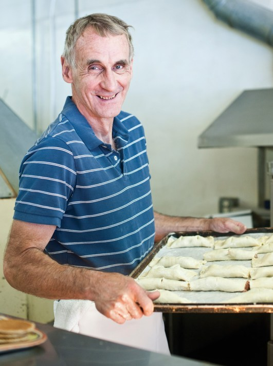 "Jan Boogman on his way to the oven with a tray of Dutch sausage rolls (""saucije broodje,"" which means, ""little sausages"")."
