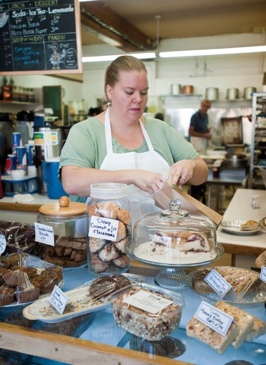 Zana Wright bags up pastries to-go for a customer.