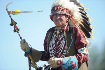 Newton Old Crow rides in one of the morning parades that wind through the encampment.