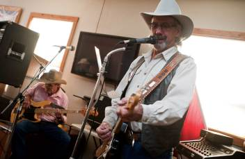 Bob Lindsay (pictured in foreground), of Country Tradition, belts out a John Conley tune as his brother — fellow bandmate David Lindsay — plays guitar behind him.