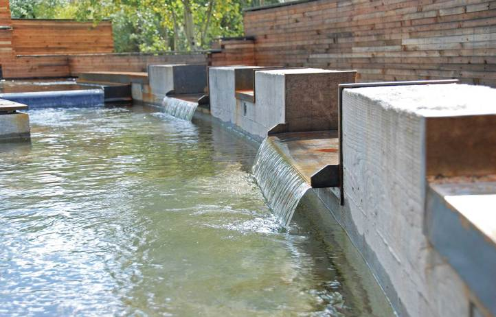 Brandner Design updated an existing water garden to flow cohesively with the style of the home's interior.