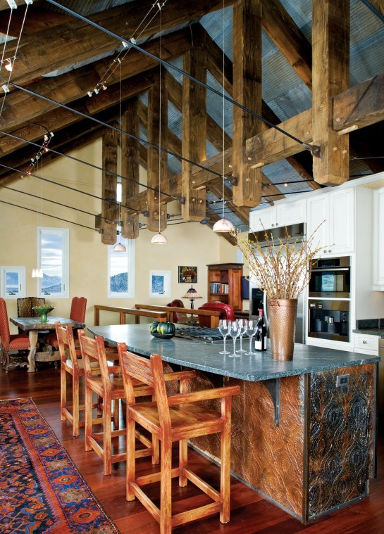 Inside the Paradise Valley home, the heavytimber roof system incorporates structural metal to provide a modern feel.