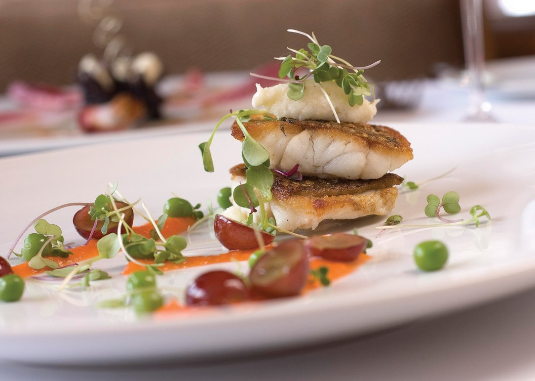 A pan-roasted snapper entree showcases chef Jake's simple, elegant presentation. Photography courtesy Triple Creek Ranch