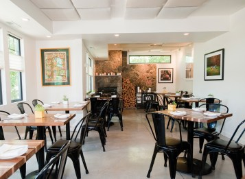 A crisp, modern decor forms a fresh perspective for an Indian restaurant. The building has taken many forms through the decades, but it was originally the farmhouse on the Kirk Homestead built in the late 1800s.