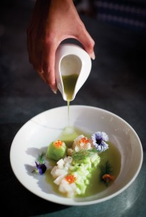 Scallop crudo and cucumber sorbet are garnished with dill and smoked trout roe.