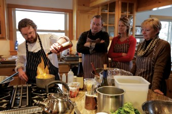Chef Jake fires up the guests during his hands-on cooking classes. Everyone leaves smarter, and full. Photography courtesy Triple Creek Ranch