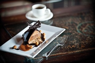 """Dessert first! This signature death-by-chocolate dessert is called the """"Coeur de Bretagne."""" It features both dark chocolate and milk chocolate mousse, layered with hazelnuts and sea salt caramel, enrobed in a chocolate glaze."""