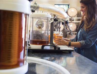 """Mary Pat Harris helps bottle whiskey along with managing sales and helping out behind the bar. """"We're making it, we're bottling it in the back, everything goes on here,"""" Jim Harris said. """"It's like a pizzeria."""""""