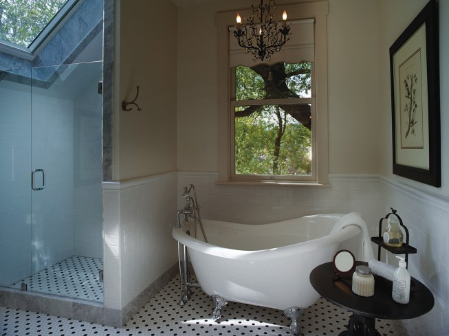 The expanded bathroom holds onto the homesteader theme but with bright, modern conveniences.