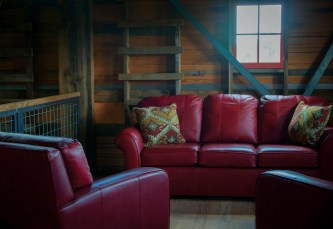 Koelzer used furniture, rugs, and accessories from Montana Expressions to create a sitting area in the barn.