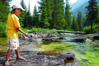 In search of Bob, Quinn sets the hook on a fish in Blodgett Creek. Photo by Julie Lue