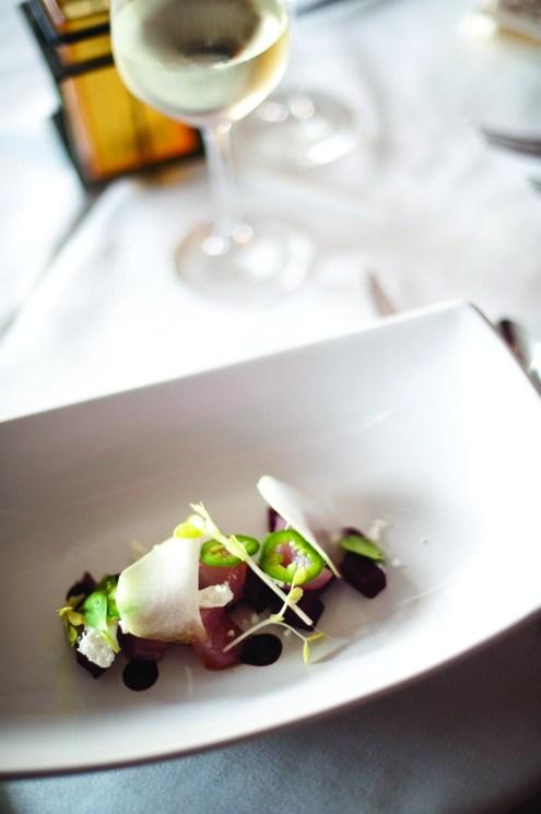 Ahi tuna with jalapeño, chevre, roasted beets, huckleberry and popcorn shoots.
