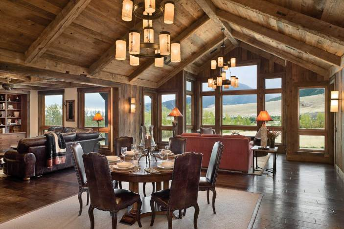 The great room includes the kitchen, dining area, and two living areas with spaces to watch television or just take in the view. Interior designer Alison Michelotti of Billings sourced many of the home's furnishings from the Red Lodge-based design firm Kibler & Kirch.