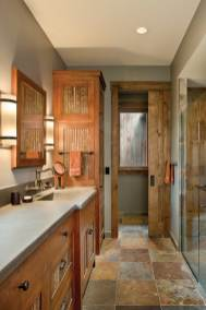 In the bathrooms, zero-threshold showers and linear drains provide convenience while repurposed corrugated roofing adds a rustic touch. Throughout the home, in-floor radiant heat makes life cozy.
