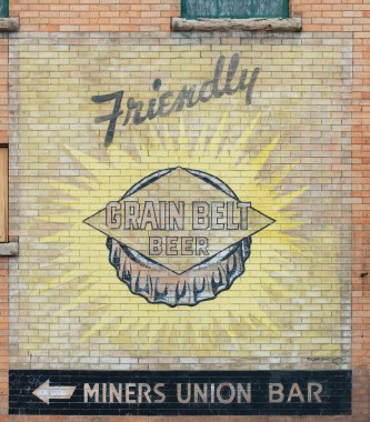 According to photographer Dr. Ken Jones, the Grain Belt Beer sign, above, was lost when the building was demolished. But that tear down exposed the beautiful Caporal Cigarettes sign to the left.