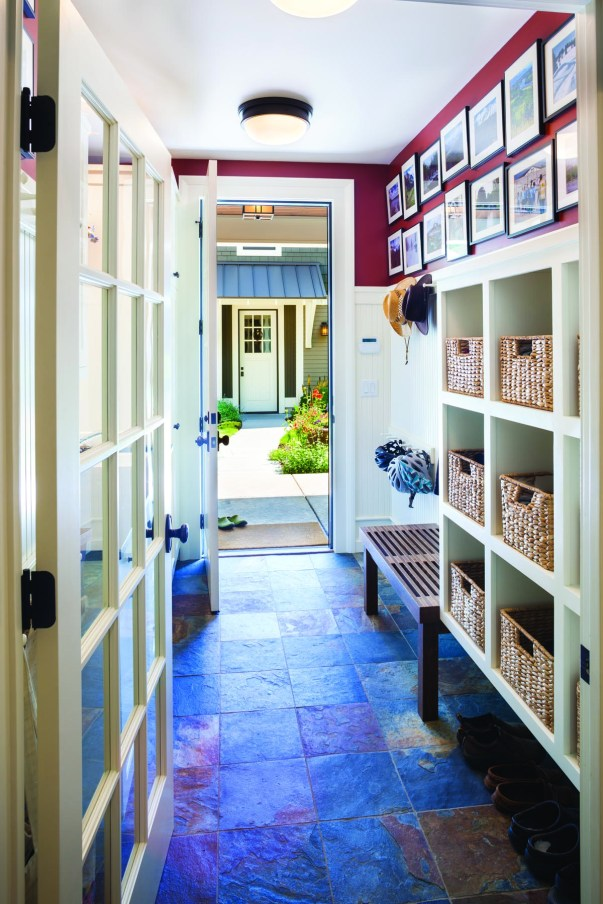 A mudroom offers plenty of space for outdoor gear and leads outside to the detached garage.