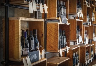 Chris McKeague's iron and wood boxes serve as a focal point for a wine bar and tasting room in Helena, Montana.
