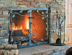 Gilmore's delicate leaf work on a fire screen complements his hand-wrought fireplace tools that grace the hearth.