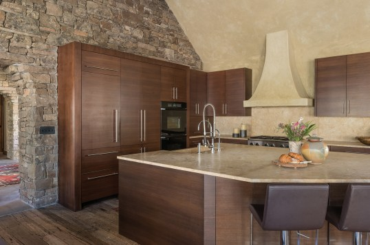 A large kitchen island provides plenty of space for prepping food, dining, and socializing.