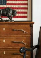 A Sarreid chest of drawers is accented with antler pulls.