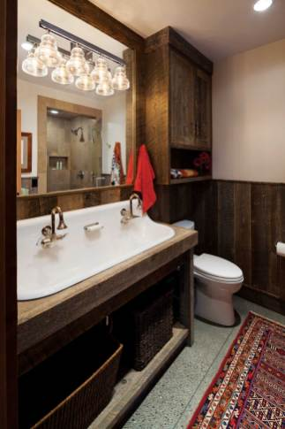With an eye toward achieving a certain cohesiveness throughout the home, Brechbuhler Architects selected the stains, wall colors, tile, and countertops, as well as all the cabinet fixtures and bathroom accessories