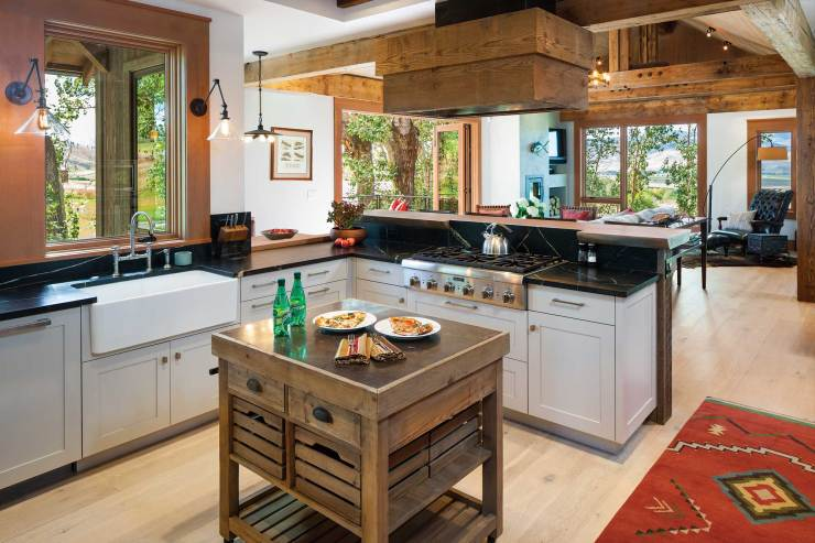 The kitchen, where the homeowners spend most of their time, is open to the great room, allowing conversations to flow freely across the space.