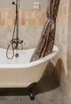 Bathroom tiles echo the palette used throughout the house.