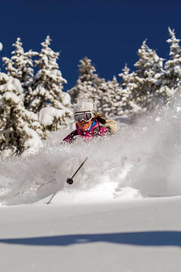 Snow flies as Charlotte Moats skis Teton Pass. Photo by Jonathan Selko
