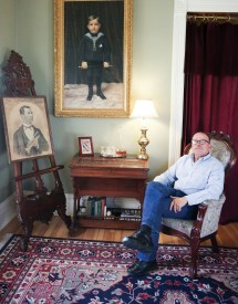Rock with a photo of his great-grandfather, Alf T. Ringling, and a boyhood portrait of his grandfather, Richard.