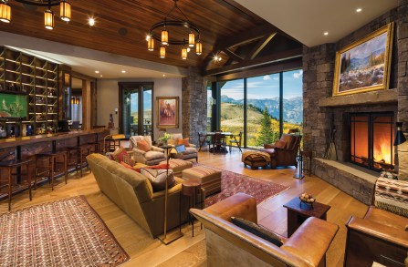 The home, designed by Keith Redfern of Concept Seven Designs and built by Mike Zoske of Zoske Construction, celebrates contemporary mountain style with ample use of wood and stone and large expanses of high-efficiency windows.