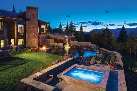 The project included extensive water features which attract wildlife, create outdoor gathering spots, and emphasize the home's relationship to nature.