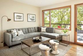 An upstairs lounge area connects to an expansive, open patio