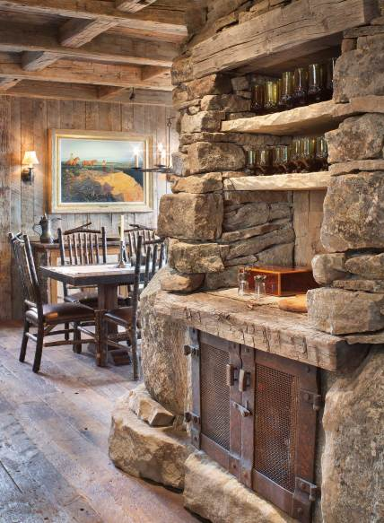 The bar, built into the central fireplace, faces the kitchen and is readily accessed from both the living room and the dining room.