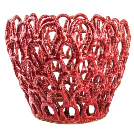 """Moon works with thin, delicate coils to create large pieces that defy gravity and the kiln's intense heat. At 14 inches tall and 15 inches in diameter, """"Red Planter"""" is an example of the artist's technical dexterity."""