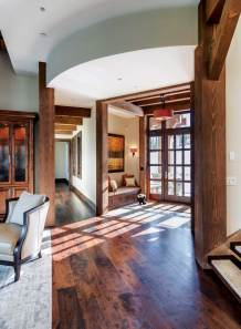 """We designed the ceiling to step up as you enter the main space from the entry hall,"" said architect Bob Brooks. ""The ceiling opens up just as the views open up."""