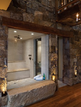 A steam room is ensconced in stone on the lower level and is located directly across the hall from the ski room, a convenient feature on a cold day