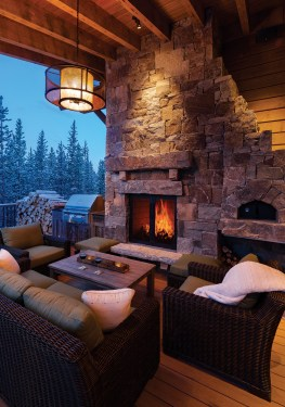 """An outdoor fireplace is the perfect place to relax after a day on the slopes. """"These are truly custom homes in every aspect. Every home is specific to the location, the site, the typography,"""" said John Seelye, the builder."""