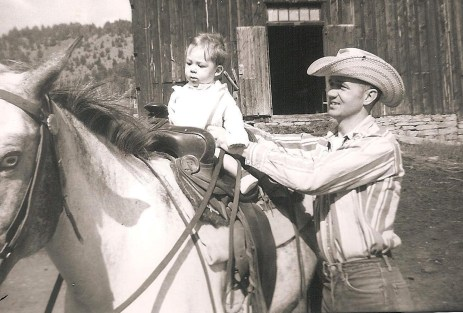 The author and his father, in 1958, on the family ranch. This was the author's first time on a horse.