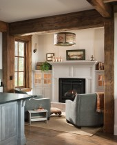 A nook with a fireplace sits off the kitchen, providing an idyllic spot for morning coffee.