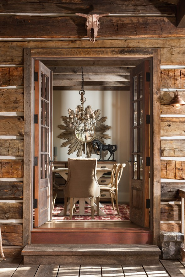Reclaimed lumber, native stone, moss-flecked rocks and vintage hardware have all been incorporated into the home.