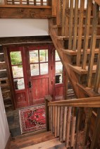The stairwell and entryway were crafted to look like an original homestead building.