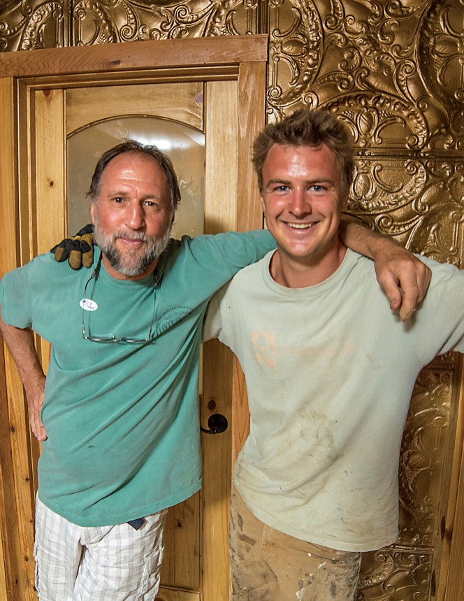 Reece stands with one of the project's chief artisans, Willie Moore. Reece, Moore, and Pete Butler combined their imaginations and their various types of expertise to create a home that revels in the unexpected.
