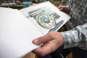 Dan Rice displays an early concept drawing of the Bozeman Reel.